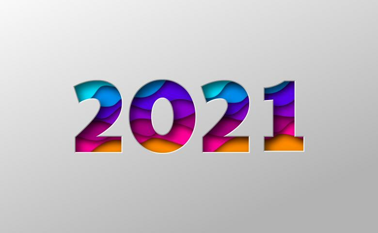 """2021"" in colourful lettering on a gray background"