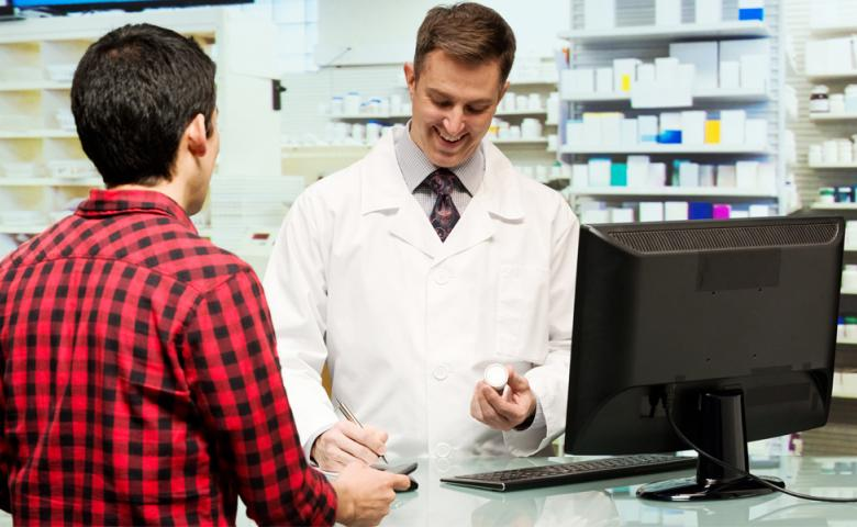 Man getting prescription from pharmacist