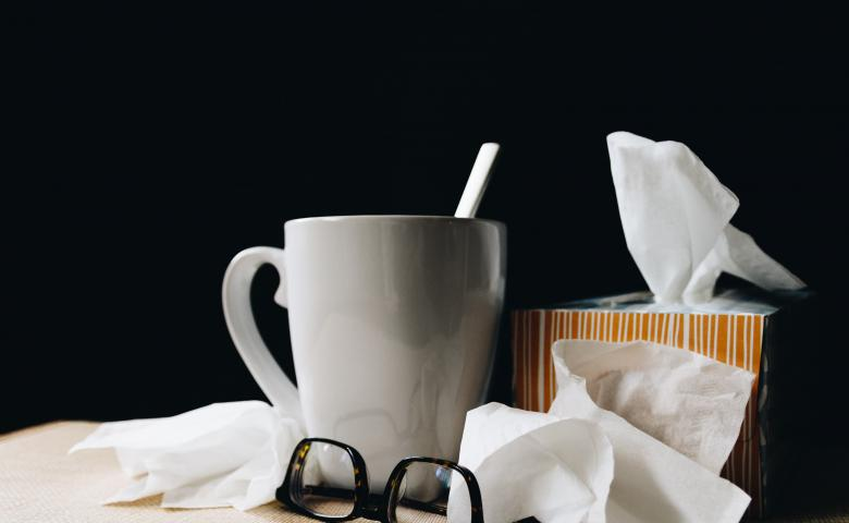 Box of tissues and mug of tea